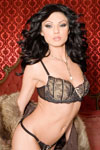 Ava Rose strips off her big fur coat and lacy lingerie in an old fashion turn-of-the-century bordello room.