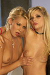 Jana Jordan and Lena Nicole love to titty69 all the time, that is whenever they're not tonguing or slurping on each other's chery lipsticked lips.