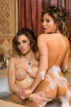 Amy Ried and Renae Cruz relax and soap up each other's naked body in a stylized Turkish bath