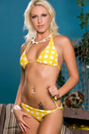 Angelica Saint models her cute itchy-bitchy yellow polka dot bikini before untying and dropping the skimpy fabrics to enjoy some nude sunbathing on a cushioned hammock