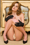Faye Reagan strikes several glamorous nude poses wearing only a set of sexy black velvet gloves and matching heels in this Penthouse softcore photo shoot.