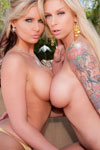 While on vacation at a tropical resort, Brooke Banner and Phoenix Marie let loose and go wild with their lesbian loving! Check out these two hot, gorgeous blondes lick and suck on each others breasts and finger-bang their pussies.