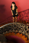 Asa Akira poses in black lingerie on a dark lovely staircase.                                                     Click to See More Penthouse Pics of Asa Akira